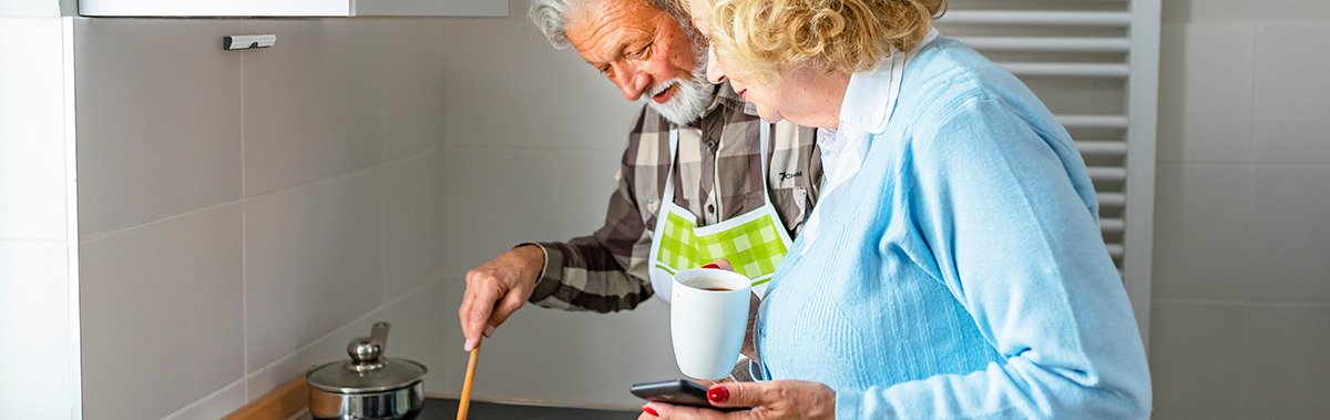 The Airis kitchen aid and fire safety device protects an elderly man while he cooks on the stove with his relative